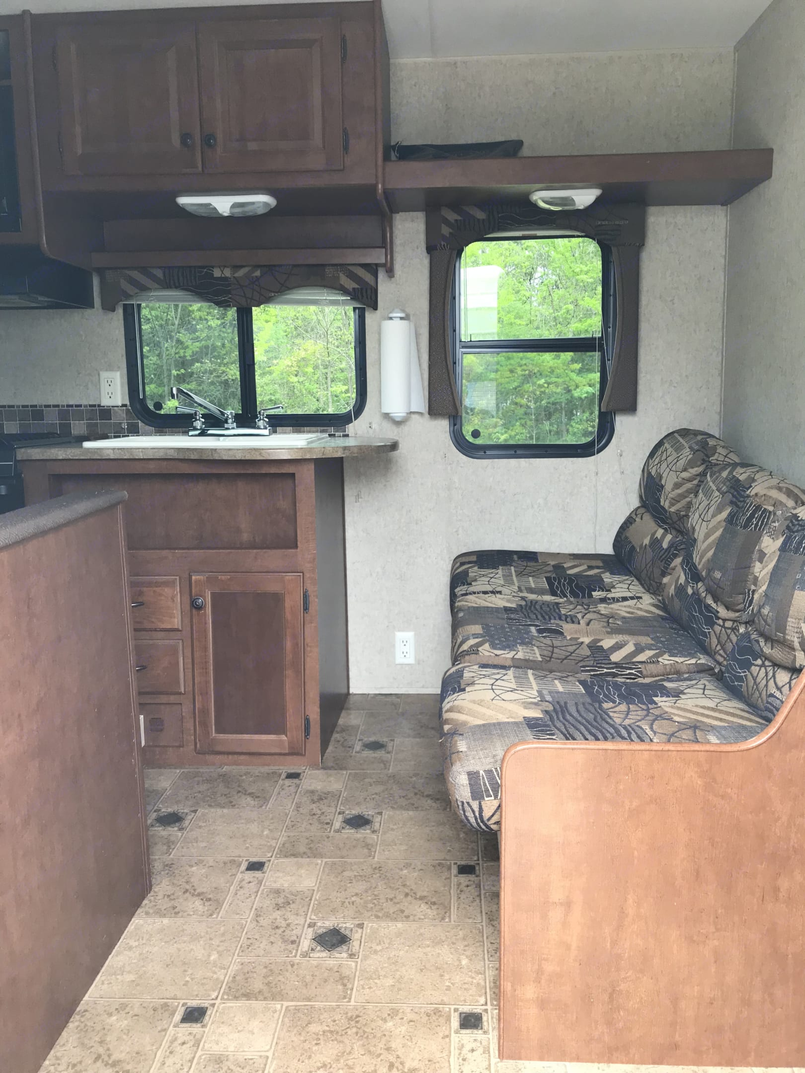 Nice sofa facing the TV. We have fit up to 4 adults on the couch.. Heartland Prowler 2012