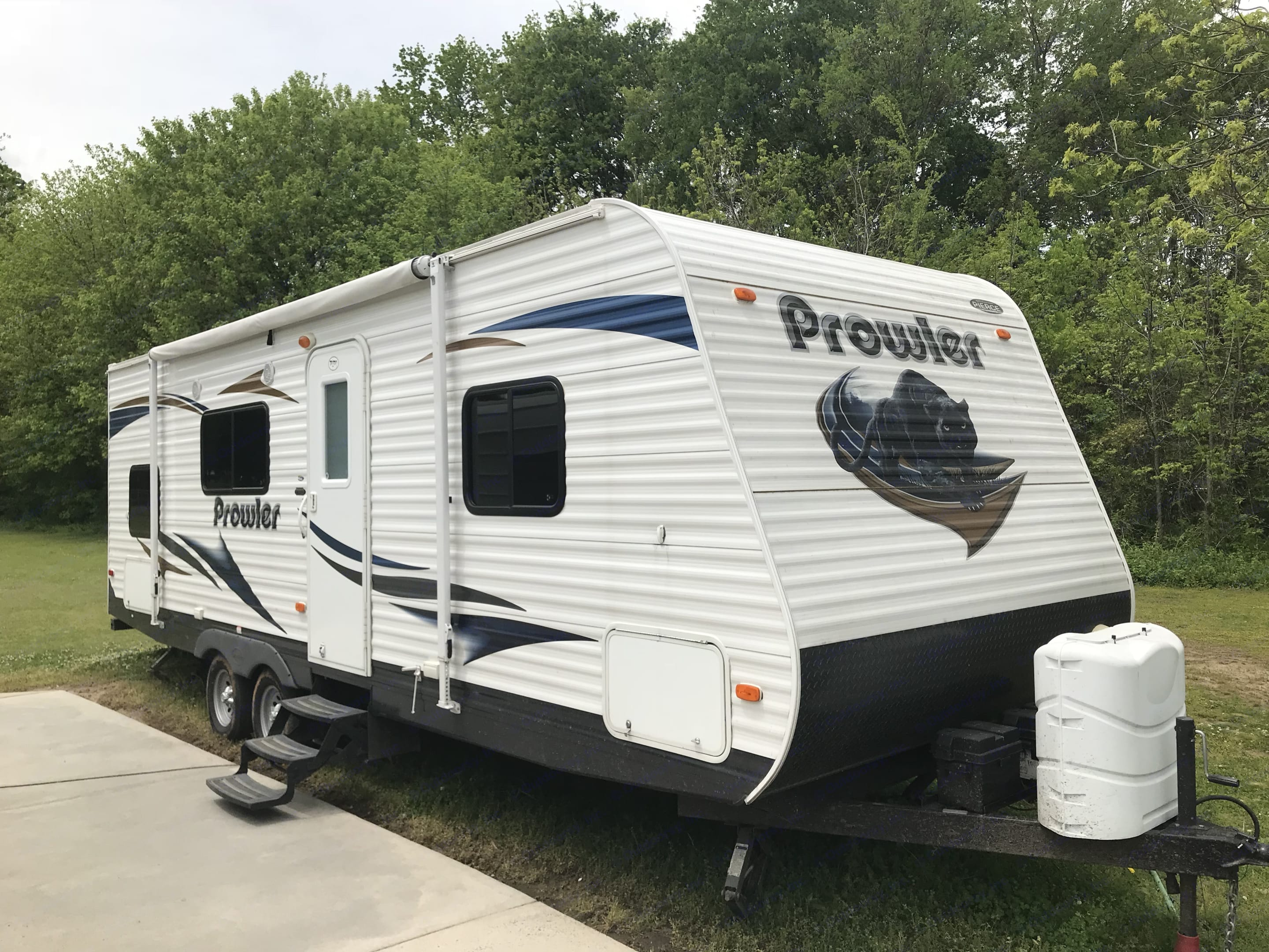 Clean exterior with functional awning, exterior storage compartments, and two larger propane tanks so you will never run out of propane. . Heartland Prowler 2012