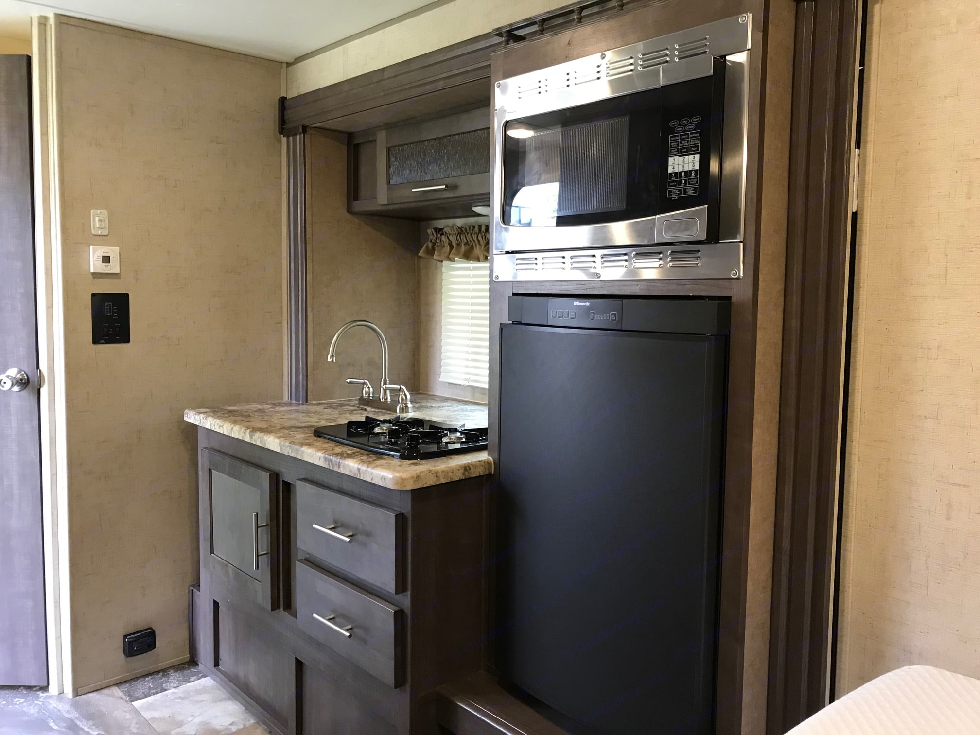 Microwave / convection oven, 3.7 cubic foot refrigerator / freezer. Forest River R-Pod 2017