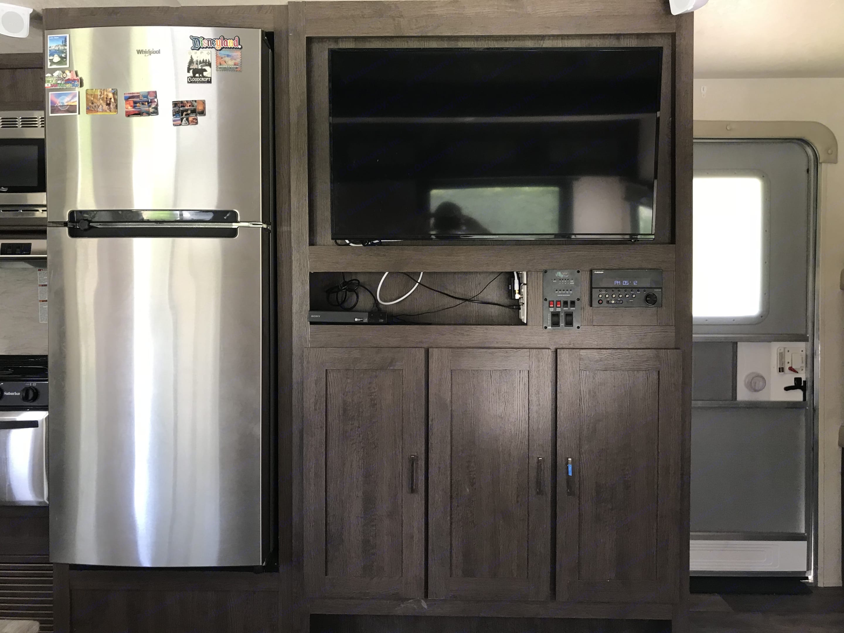 Extra Large Refrigerator for stocking enough food for your trip plus an entertainment center with a DVD player and surround sound system. Great for relaxing inside when the weather isn't nice outside. . Forest River Salem 2018