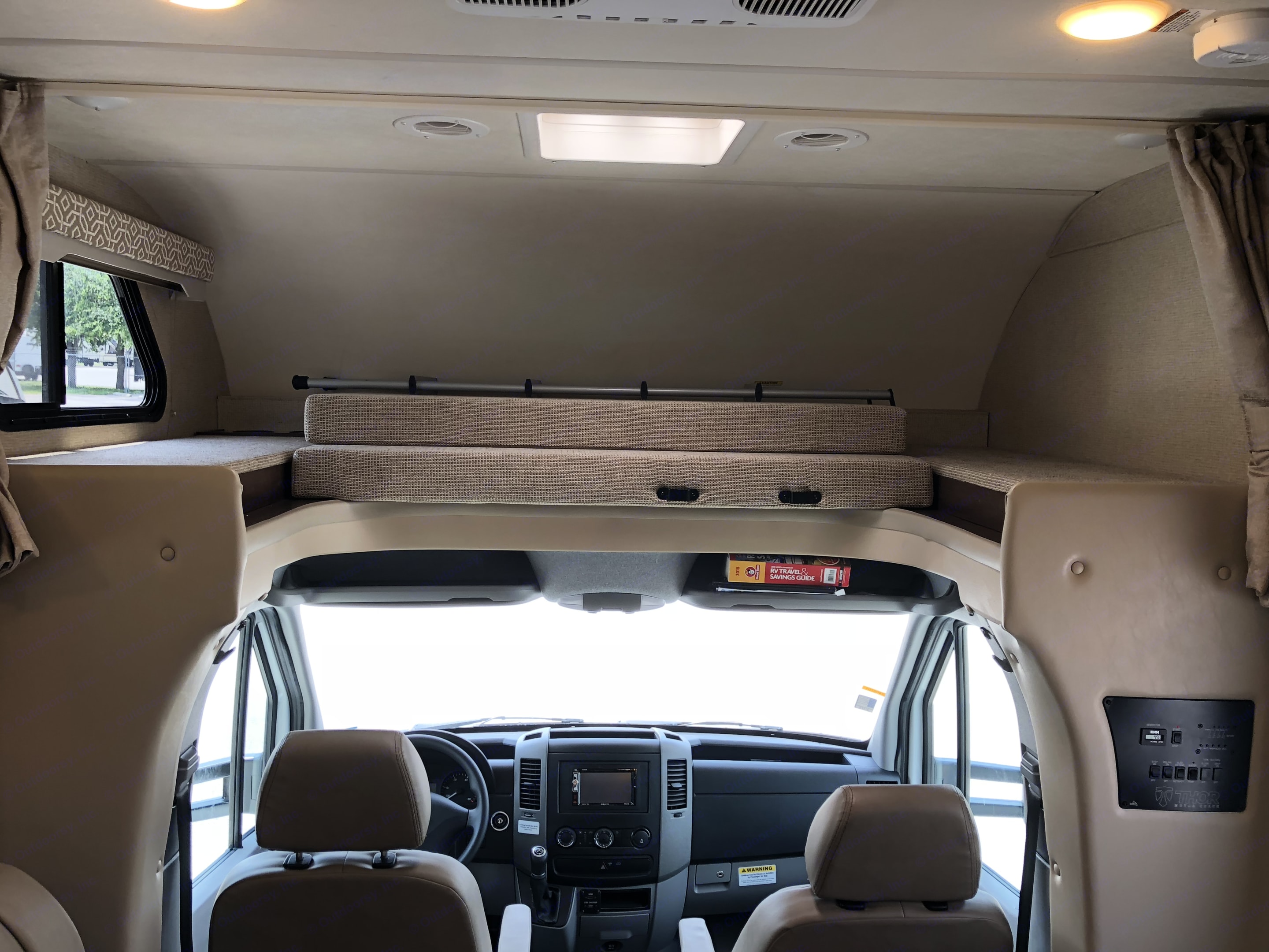 Bed above cab stored away. Thor Motor Coach Freedom Elite 2018