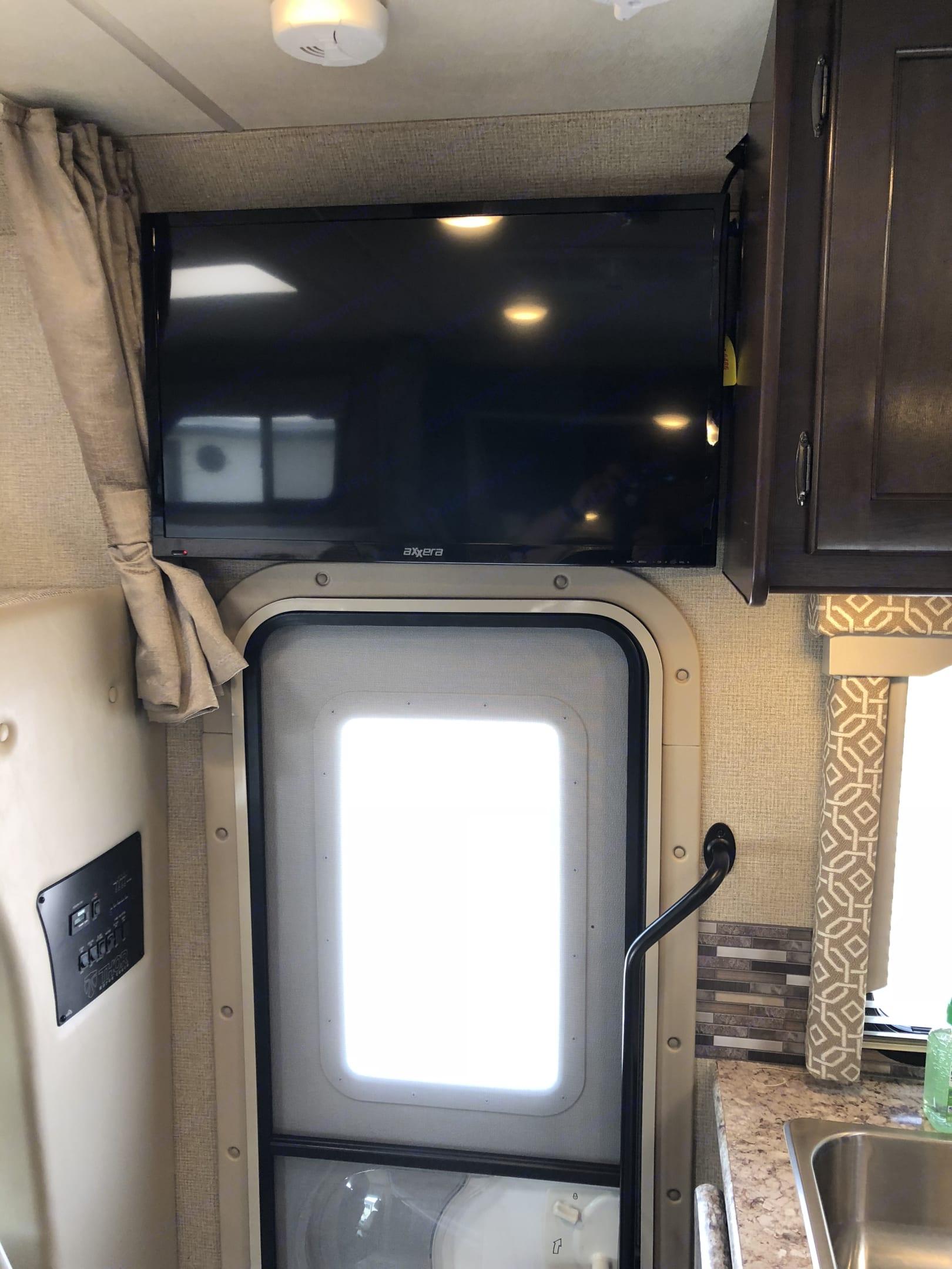 "32"" LED TV on Manual Swivel above door. . Thor Motor Coach Freedom Elite 2018"