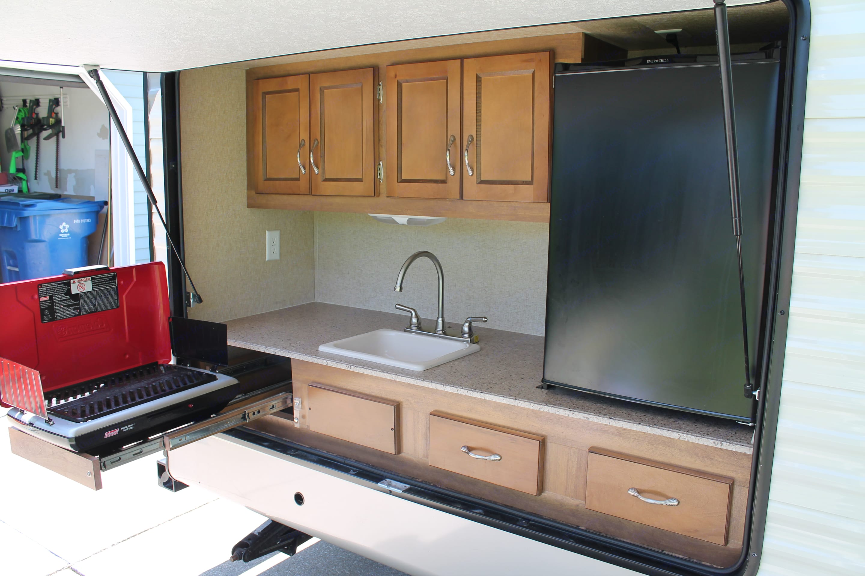 Full outdoor kitchen with gas grill and second refrigerator. Coachmen Catalina 2015