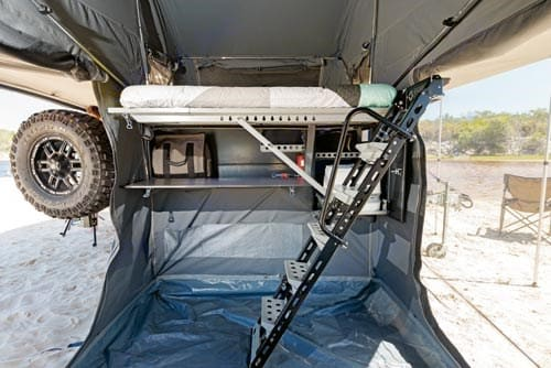 Inside - queen size bed setup, with staircase up. Patriot X1 Grand Tourer 2018