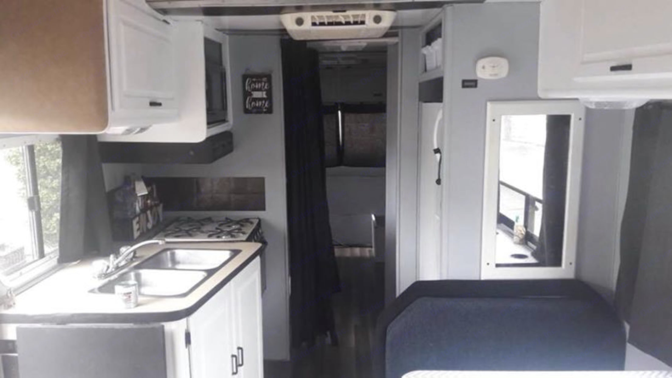 The inside features a sink, microwave, stove/ oven, vent hood, refrigerator and plenty of storage for food, dishes, etc. The hallway leads to the bathroom and then the king size bed with closet space.. Winnebago Minnie Winnie 1988