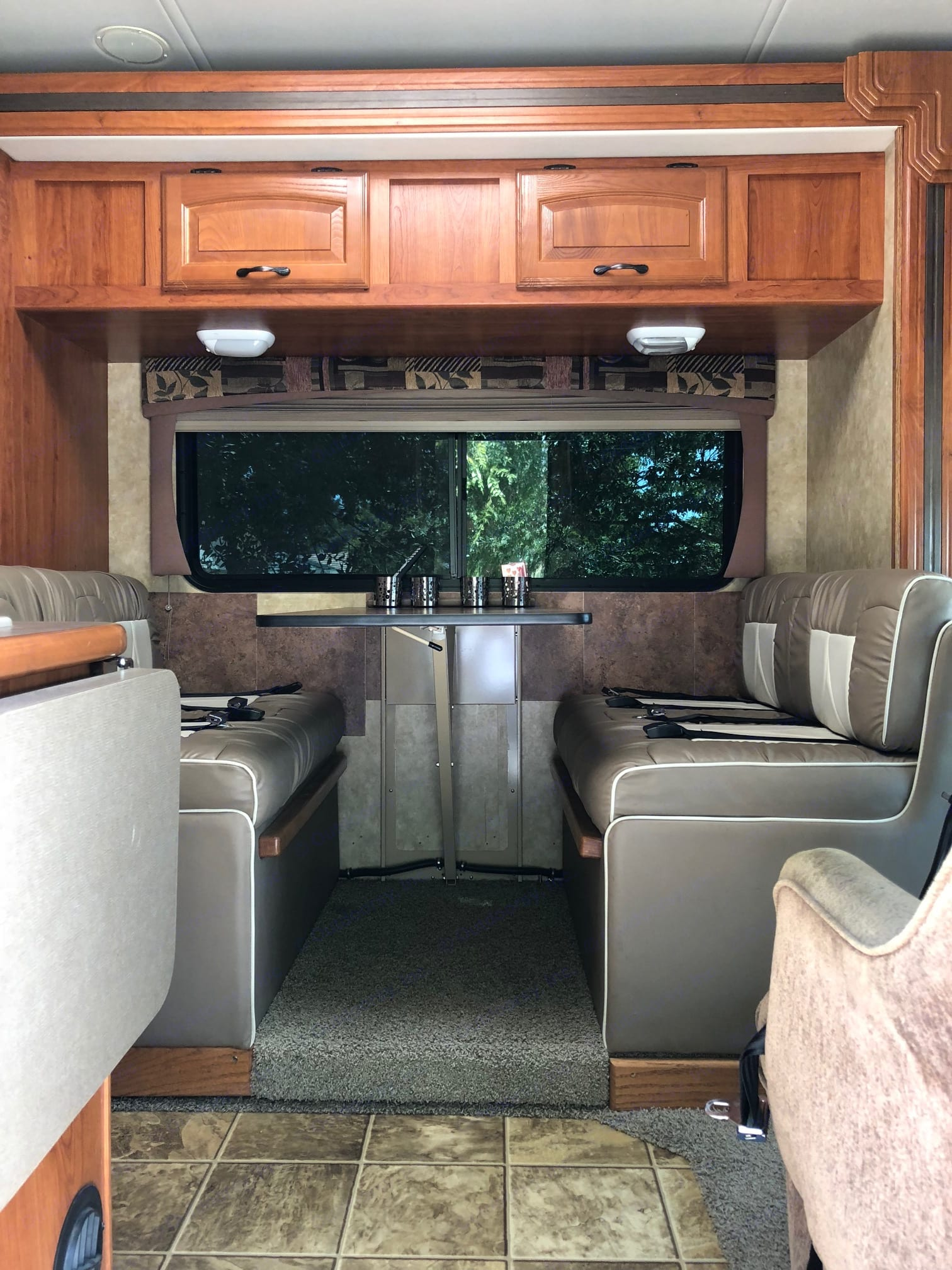 Dining area seats four very comfortably. This area also folds down into an additional sleeping area.. Coachmen Freelander 2008