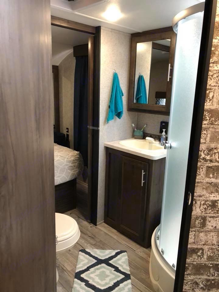 Bathroom has plenty of space and a walk-in shower. Forest River Cherokee 2018