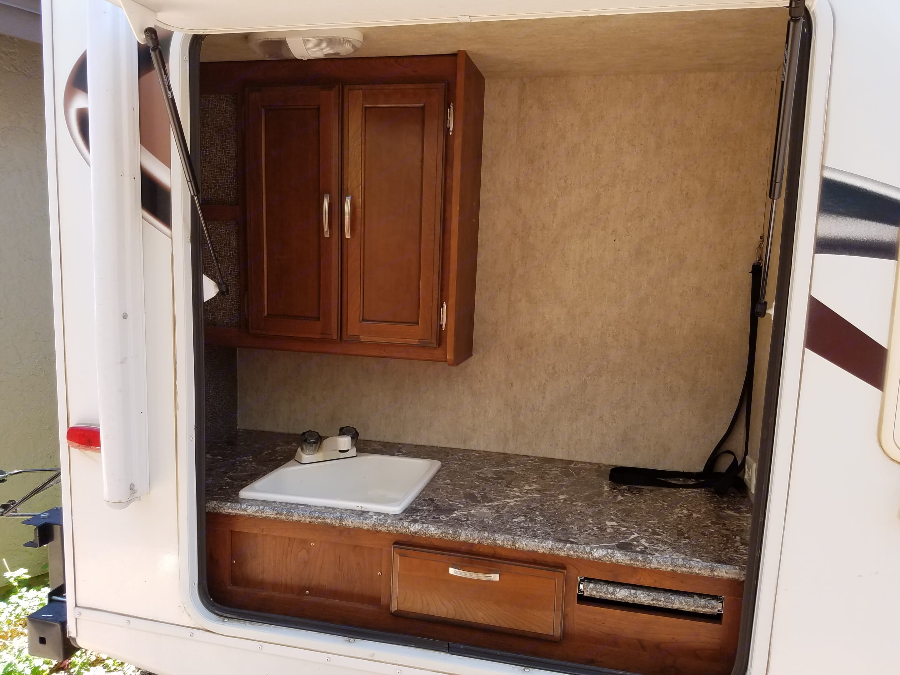 Outside kitchen. The only thing missing is the outside refrigerator. . Keystone Passport 2014