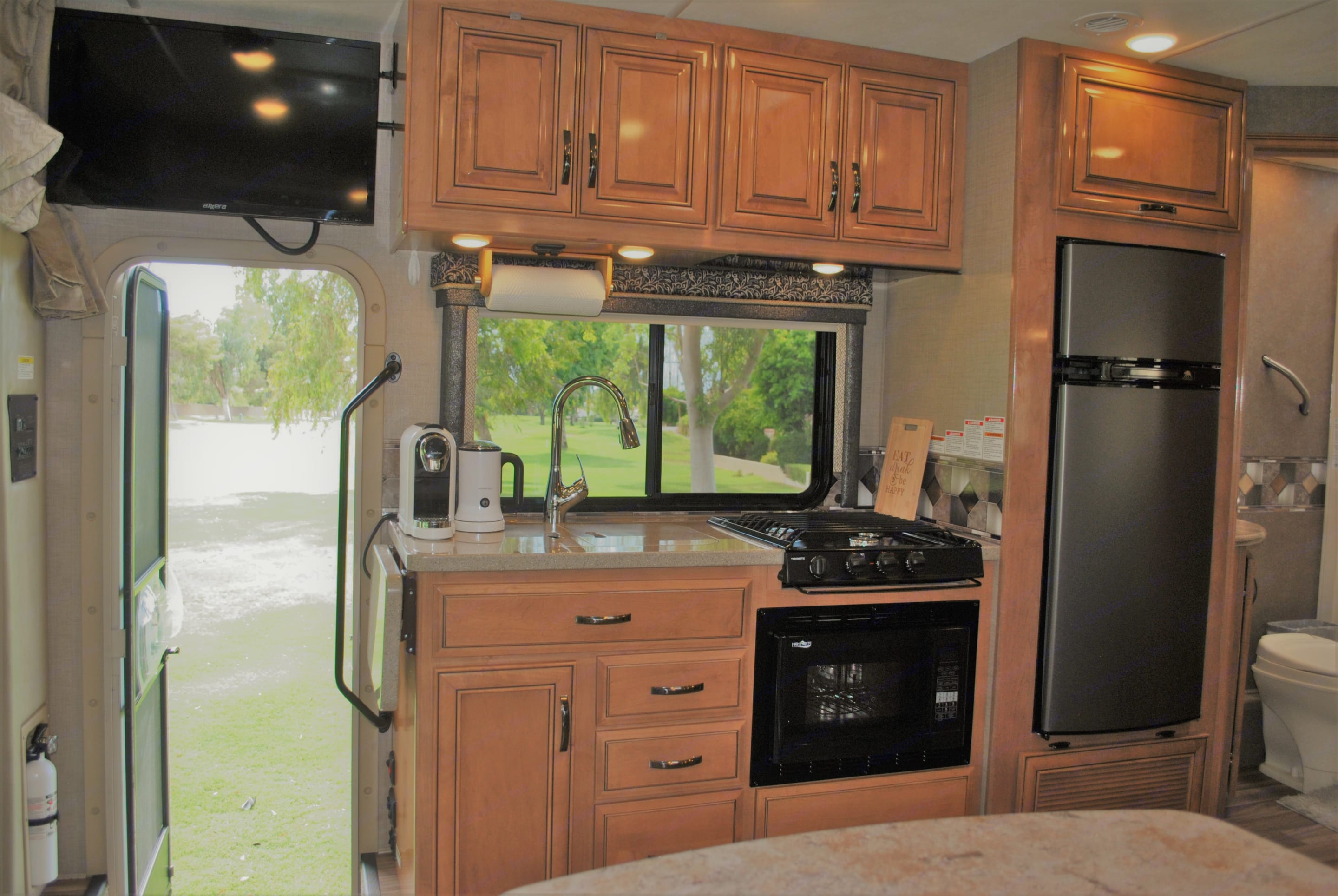 beautiful kitchen comes with just about everything you will need for your next trip. propane cook top , microwave , refrigerator ,cappuccino make and frother , toaster ,pots ,pans ,dishware ,silverware ,coffee cups , cooking utensils and much more.. Mercedes-Benz Sprinter 2018