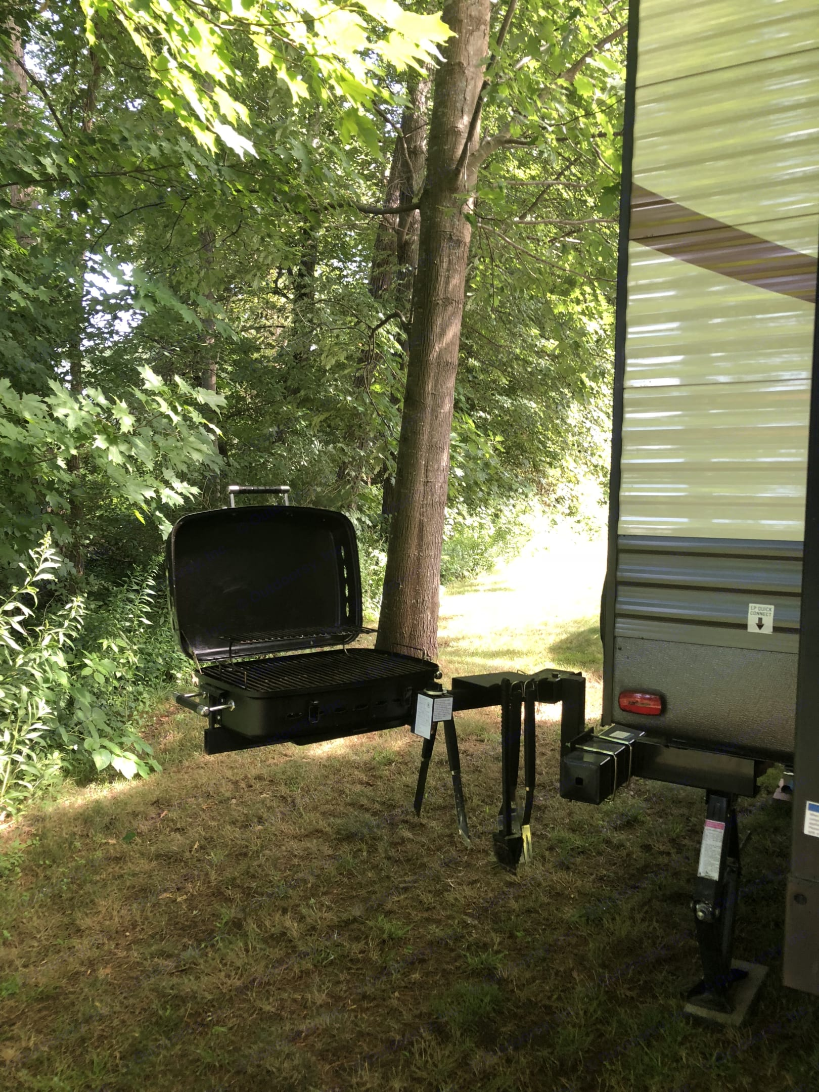 The grill hooks to the camper propane.  Works well. . Palomino Puma 2017