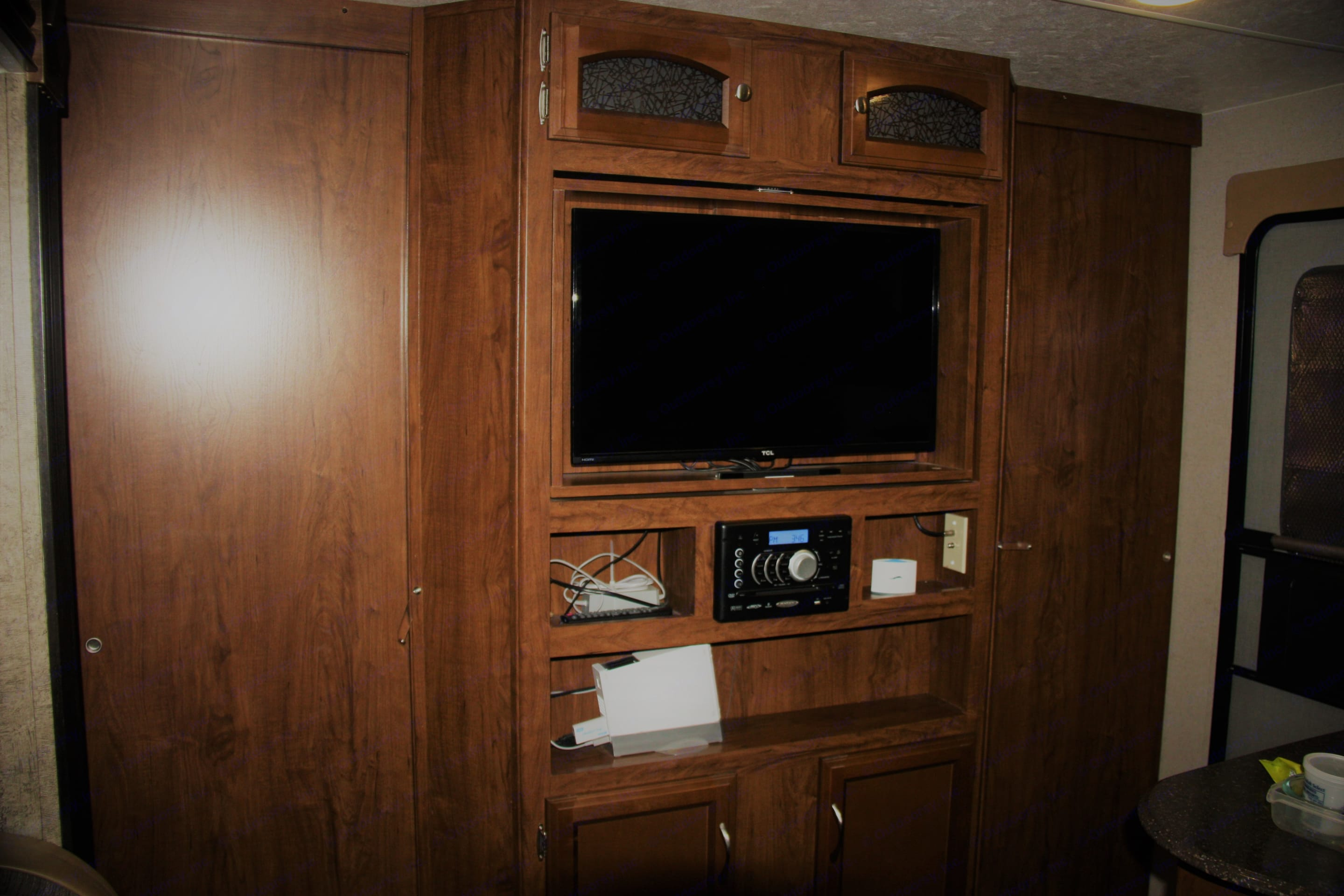 Entertainment center.  Includes a DVD player, Wii, and radio.. Coachmen Freedom Express 2017