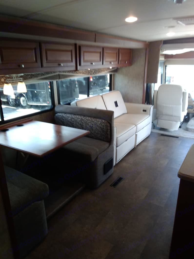 dinette and couch wthat folds out for two single beds. Winnebago Itasca Sunova 2015