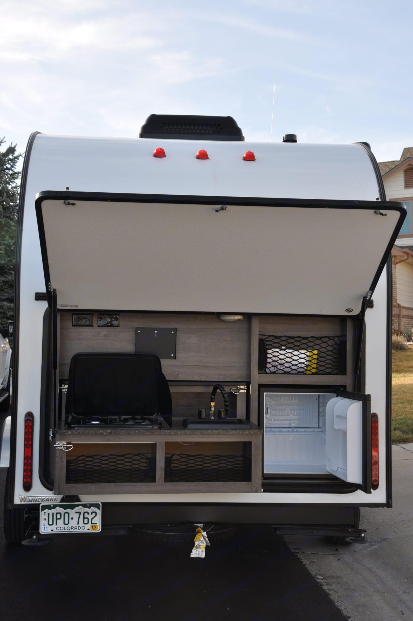 Outdoor kitchen w/2 burner cooktop, microwave, refrigerator, sink and storage. Winnebago Winnie Drop 170K 2017