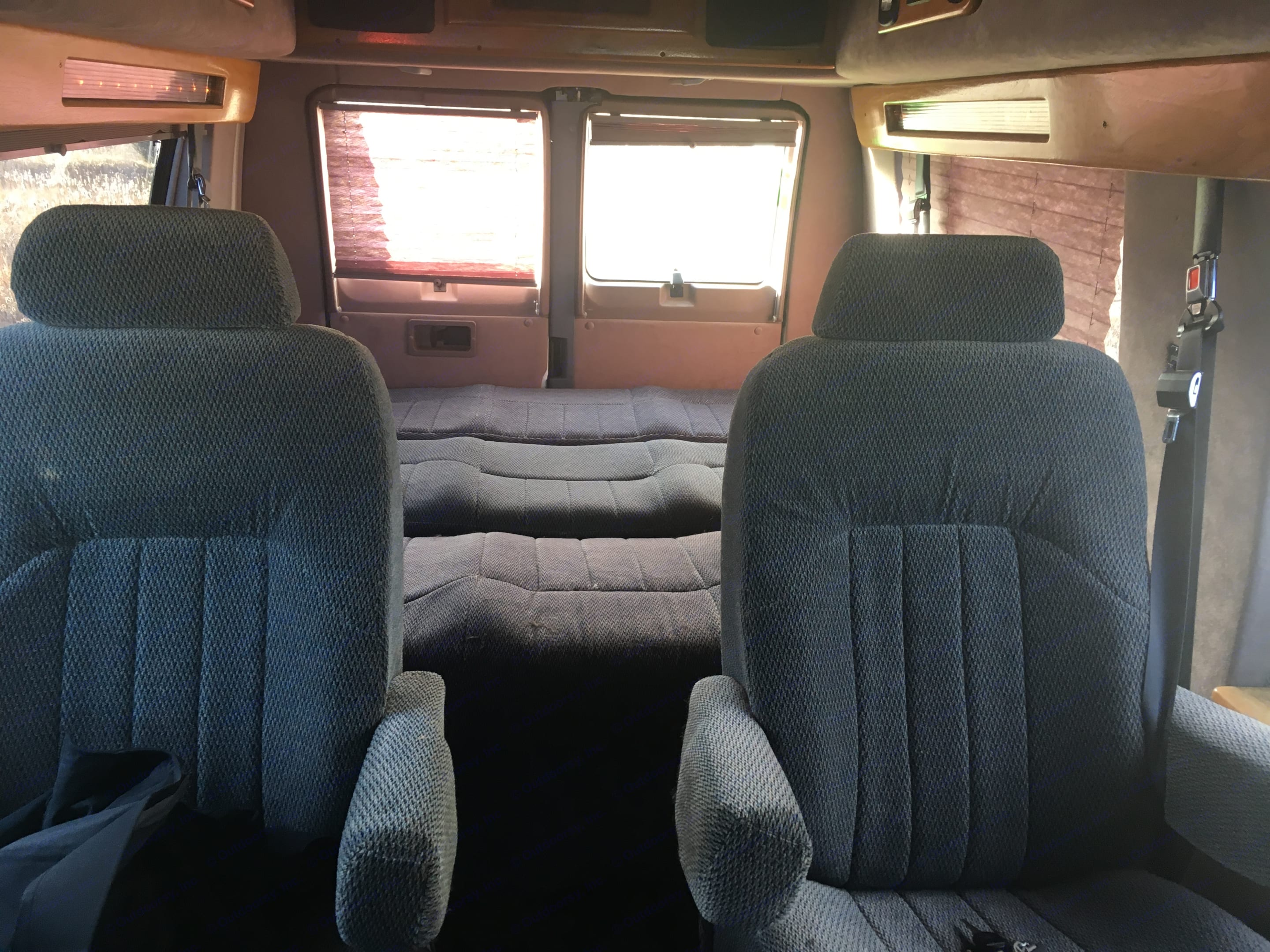 Couch folded down into large sleeping space with the push of a button. . Dodge 1500 1999