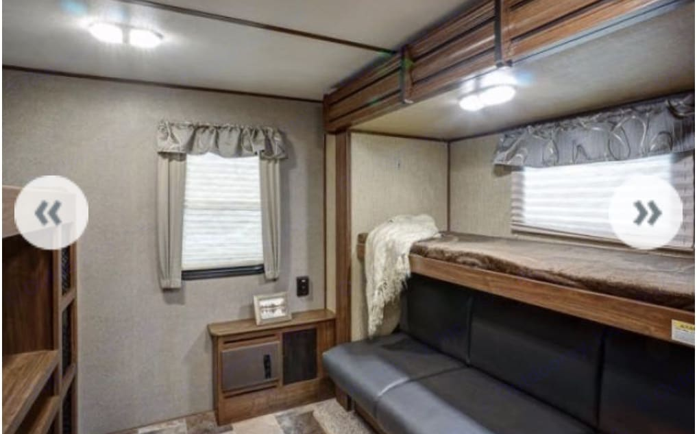 Bunk house with slideout, 2 singles and 1 double bed, couch and tv. Great place for the kids to sleep and have fun!. Keystone Sprinter 2018