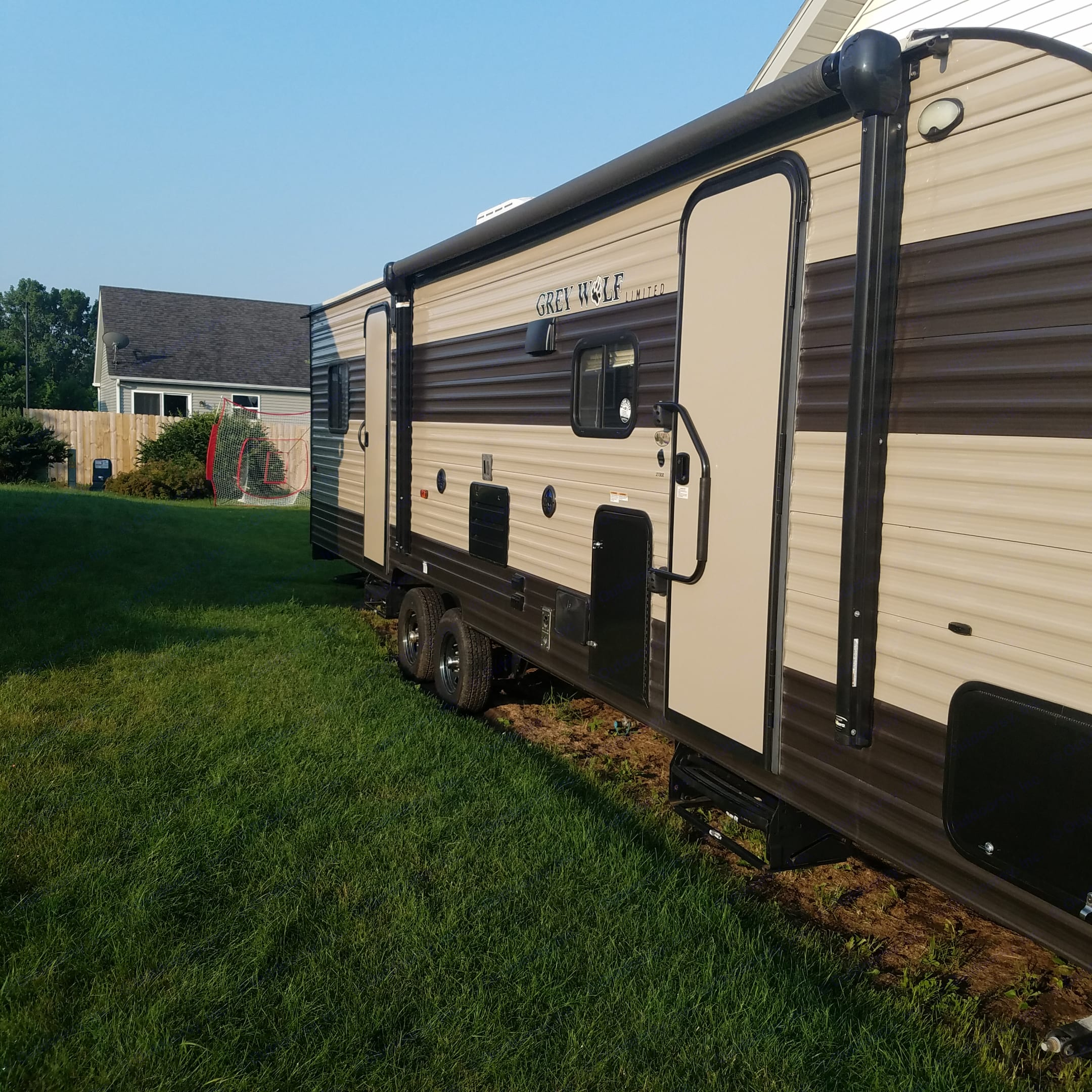 Outdoor 2 doors with awning and outdoor speaker with blue lights . Forest River Grey Wolf 2017