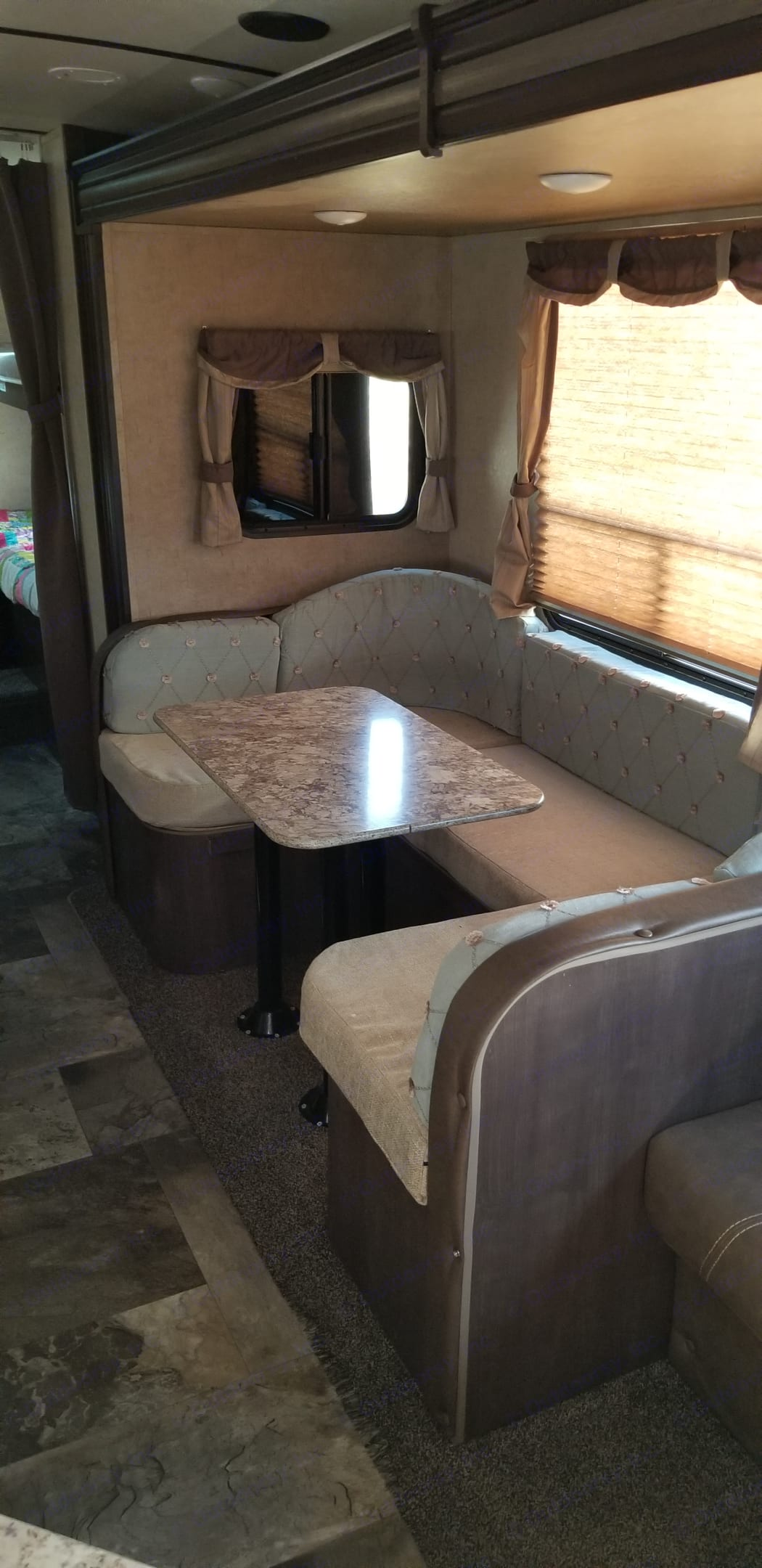 Custom upholstery.  Much nicer than the standard interior fabric.. Forest River Surveyor 2016