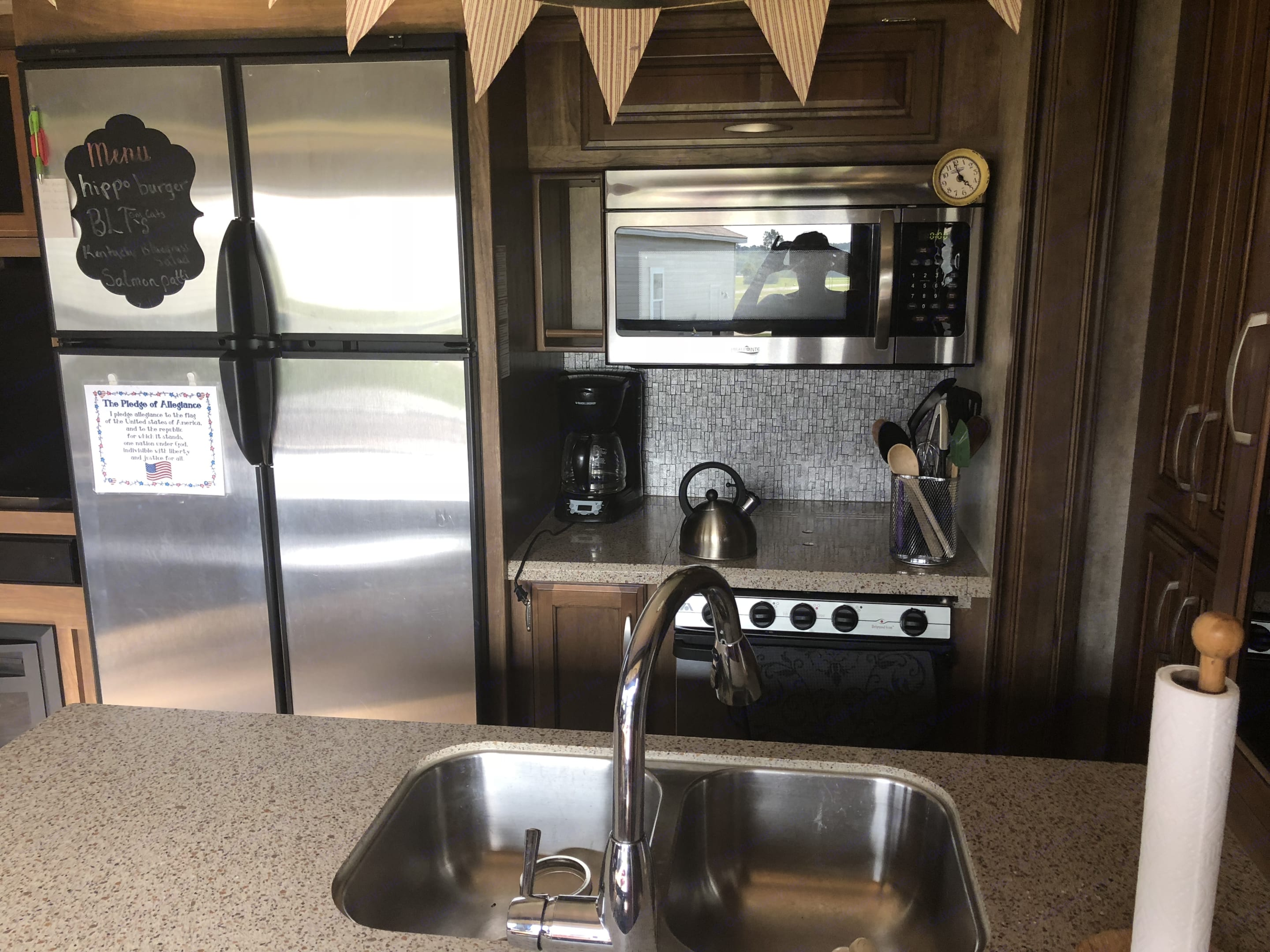 Large fridge, stove and oven. Double sink and plenty of counter space. . Keystone Montana High Country 2016