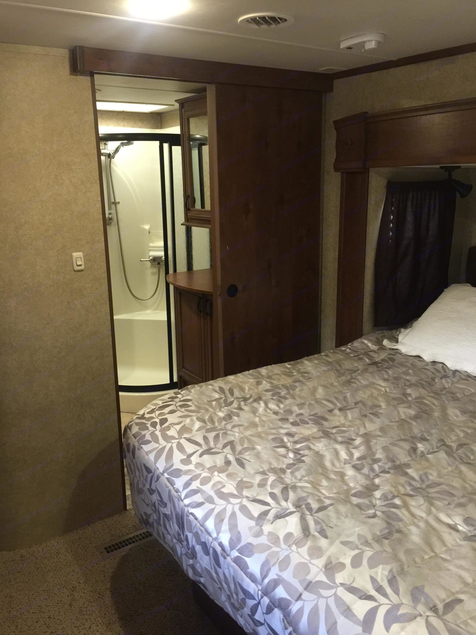 Master bedroom with view into full bathroom.. Open Range 427 BHS 2014