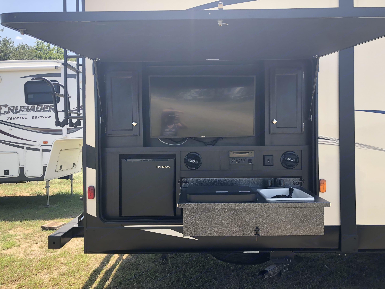 Outdoor kitchen with TV/DVD, Stove, Sink, and Refrigerator.. Venture Rv Sporttrek 2018