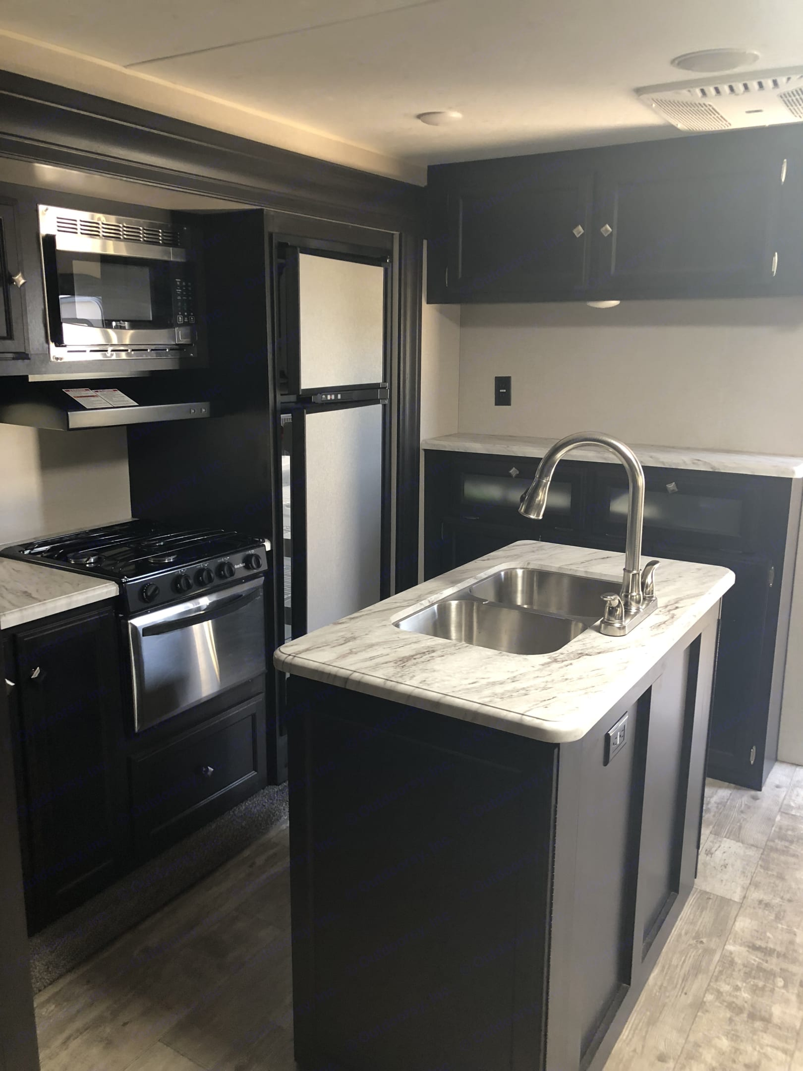 Island kitchen fully equipped with all dishes, pots, pans, and Kuerig coffee maker.. Venture Rv Sporttrek 2018