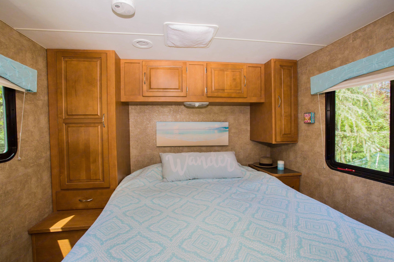 Bedroom has Queen size sleep number bed. Winnebago Minnie Winnie 2014