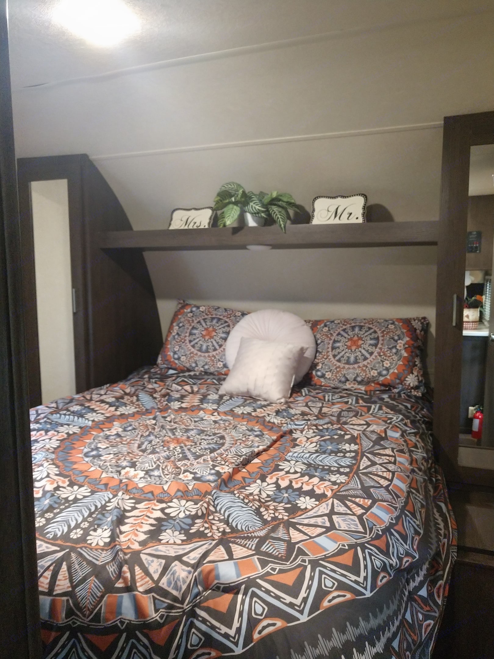 Master bedroom. Queen size bed. Walk around area at bottom of the bed. 4 cabinets for storage.. Forest River Salem 2018