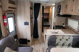 Interiorvvt is u us  GBisa was   1!Picture facing Back, Shows Kitchen area toward the Large sleeping area. Upgraded Queen Mattress.. Coachmen Freelander 2016