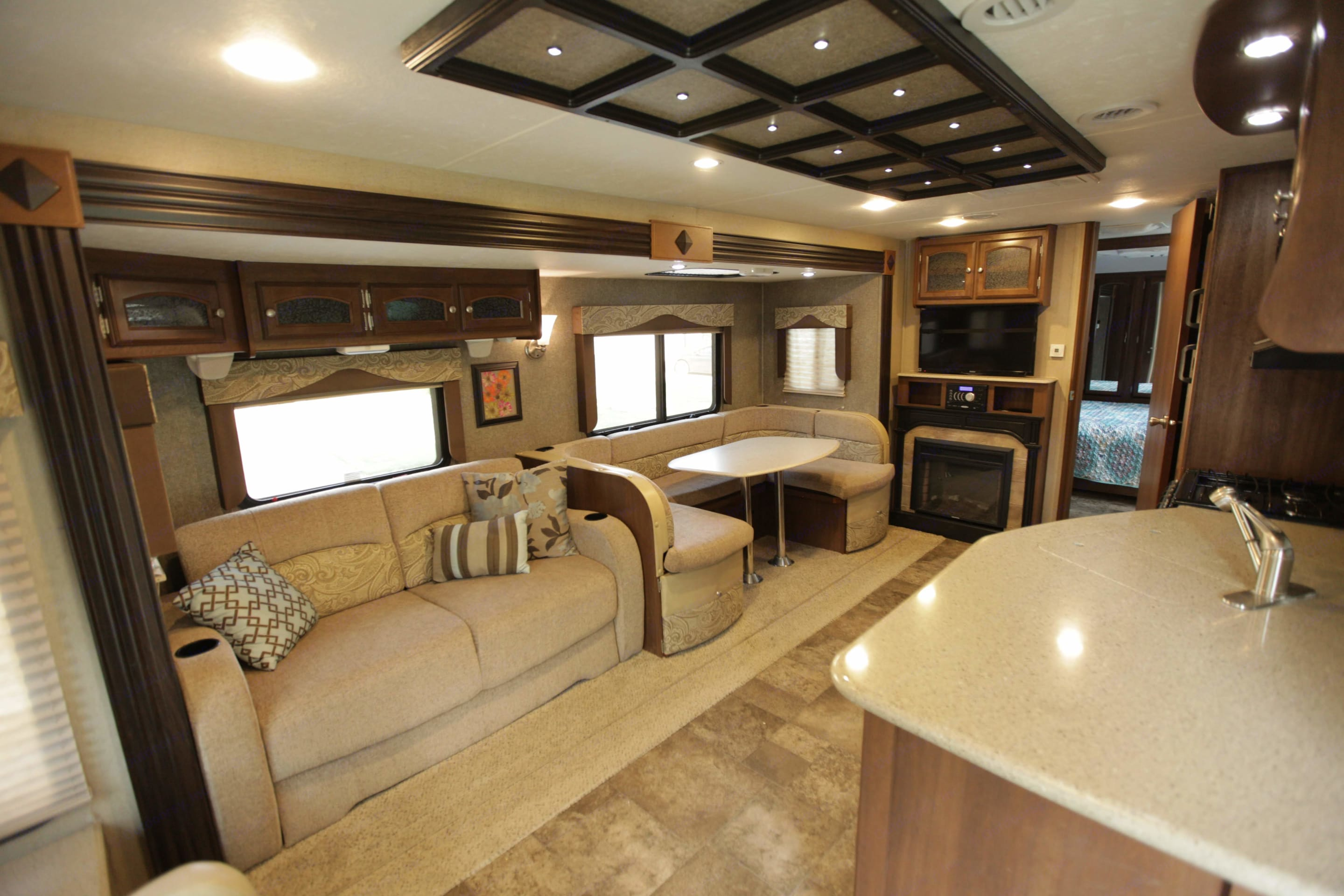 Beautiful and spacious living area with room for 8+ people to sit and enjoy each other.. Coachmen Freedom Express 2015
