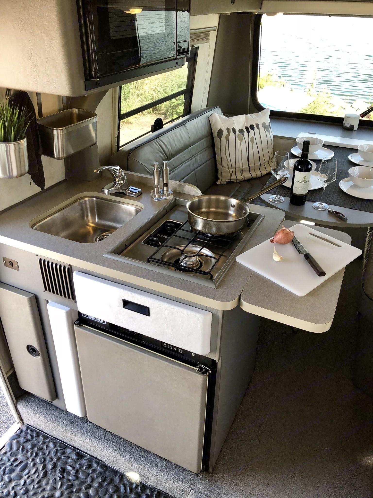 Kitchen with microwave above.. Winnebago Eurovan Camper Rialta 1997