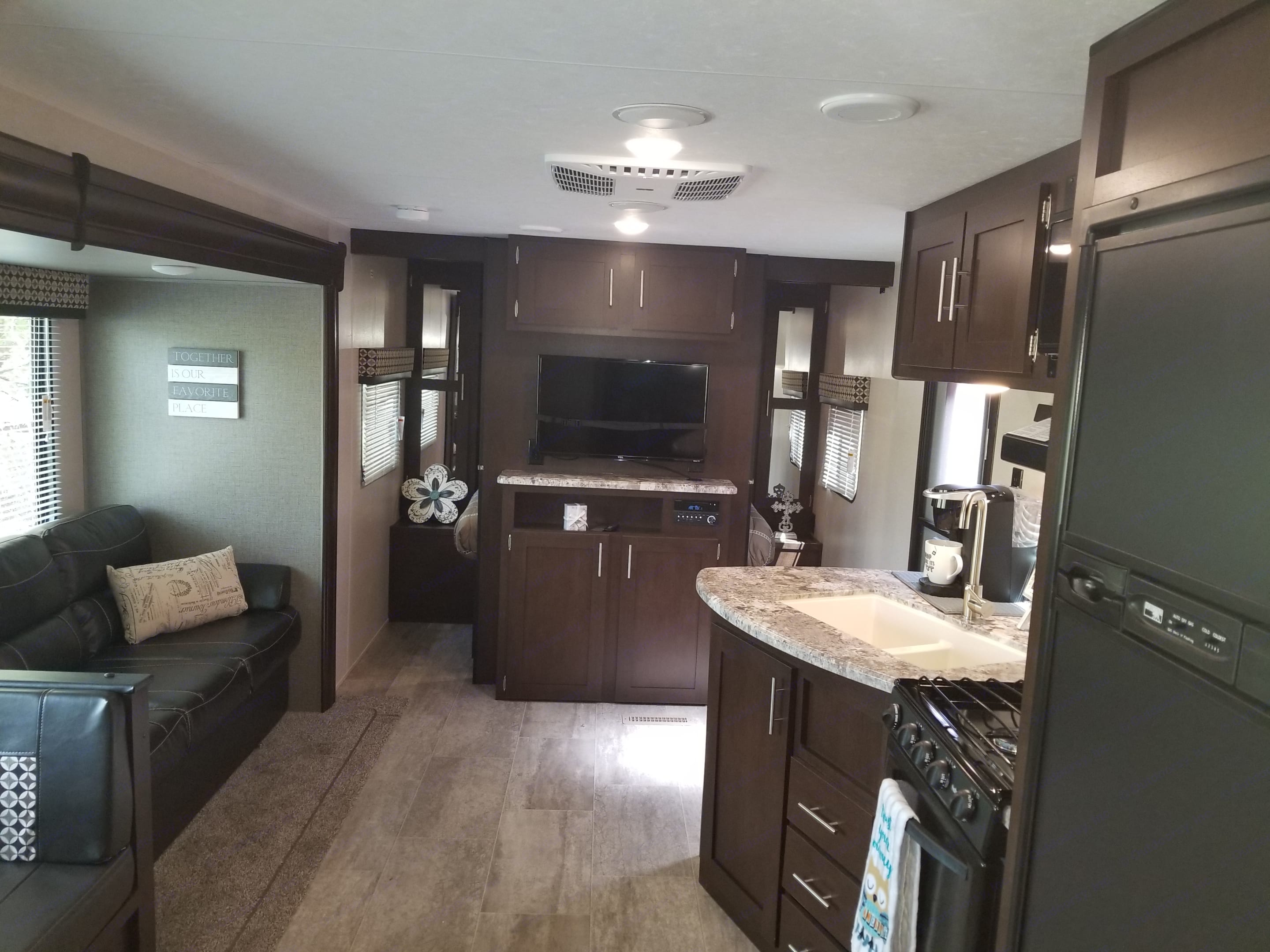 View from back of travel trailer  coming out of bathroom.. sportsmen 271BHLE 2018