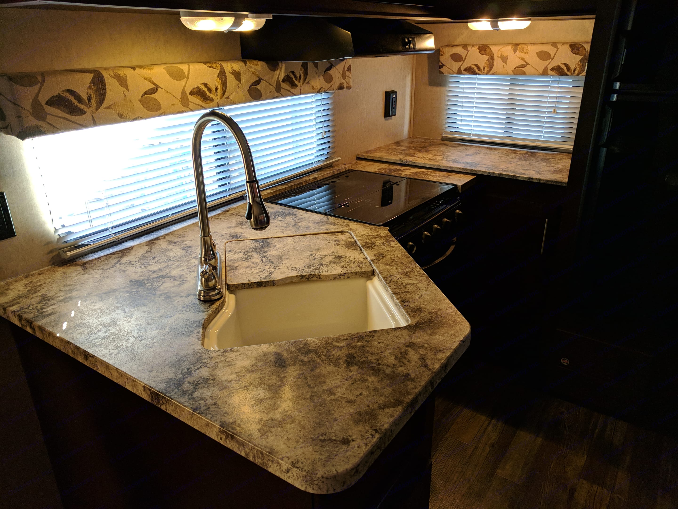 Fully stocked kitchen with microwave, refrigerator, stove and oven along with full eating service for 8 and pots/pans.. Forest River Cherokee 2016