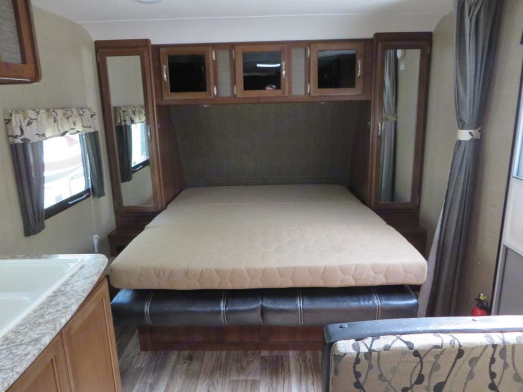 Sofa converts to a Queen sized bed. Keystone Passport Ultra Lite 2016
