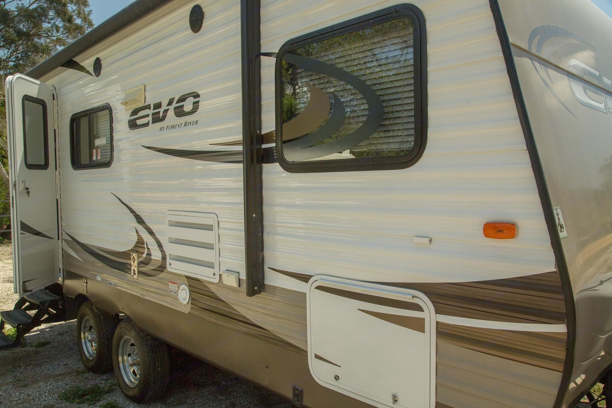 Evo by Forest River  awning and one side-out. Forest River Evo 2015