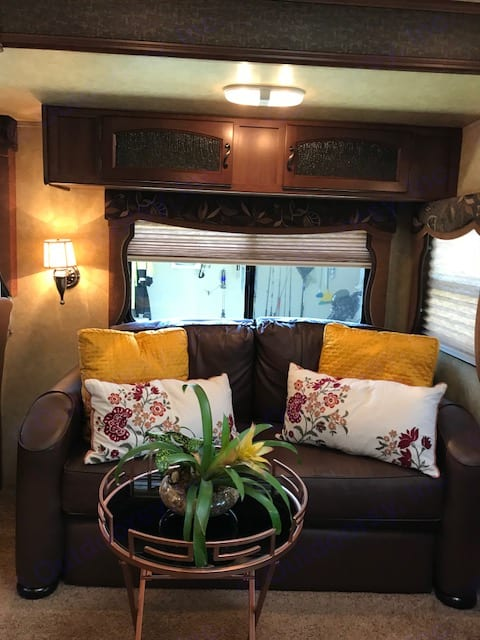 Enjoy relaxing on the couch and watching your flat screen TV. Also sleeps 2 additional people for a total of 4 ppl.. Forest River Crusader 2012
