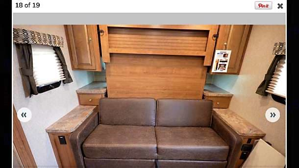 This is the murphy bed / love seat in its travel position / day time position.. Forest River Inc Rockwood Mini Lite 2509s 2018
