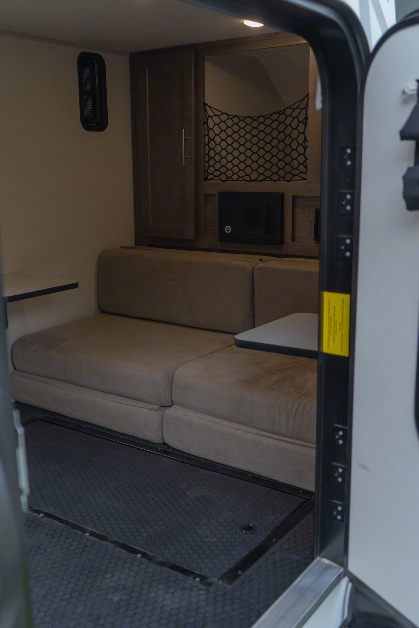 Comfy mattress that converts to couch with side tables and cup holder. . Forest River Other 2019