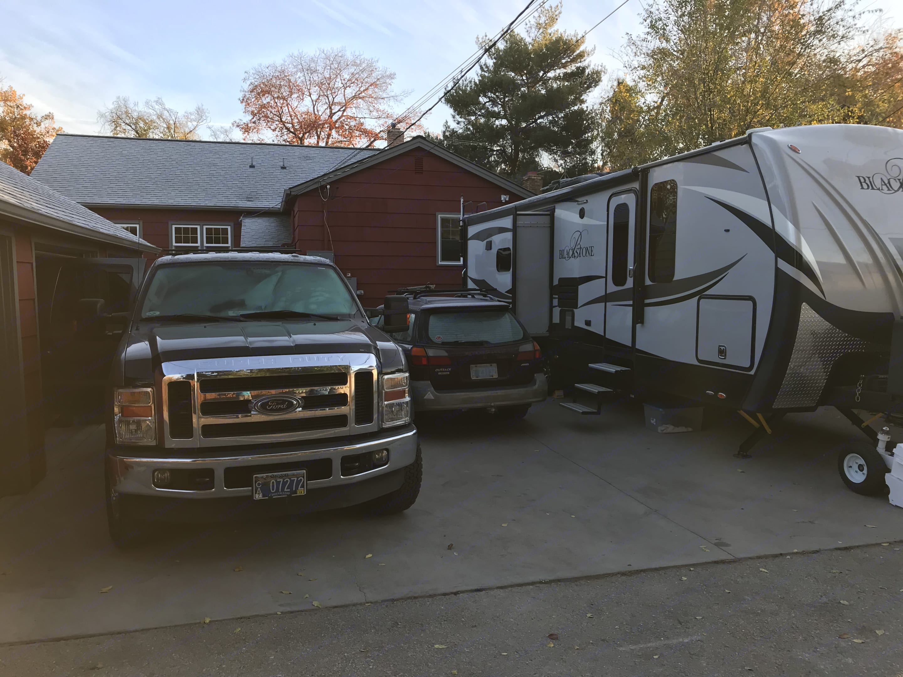Parked in the driveway of our Boise home.. Outdoors Rv (made in La Grande Oregon) Black Stone 270 CISB 2016