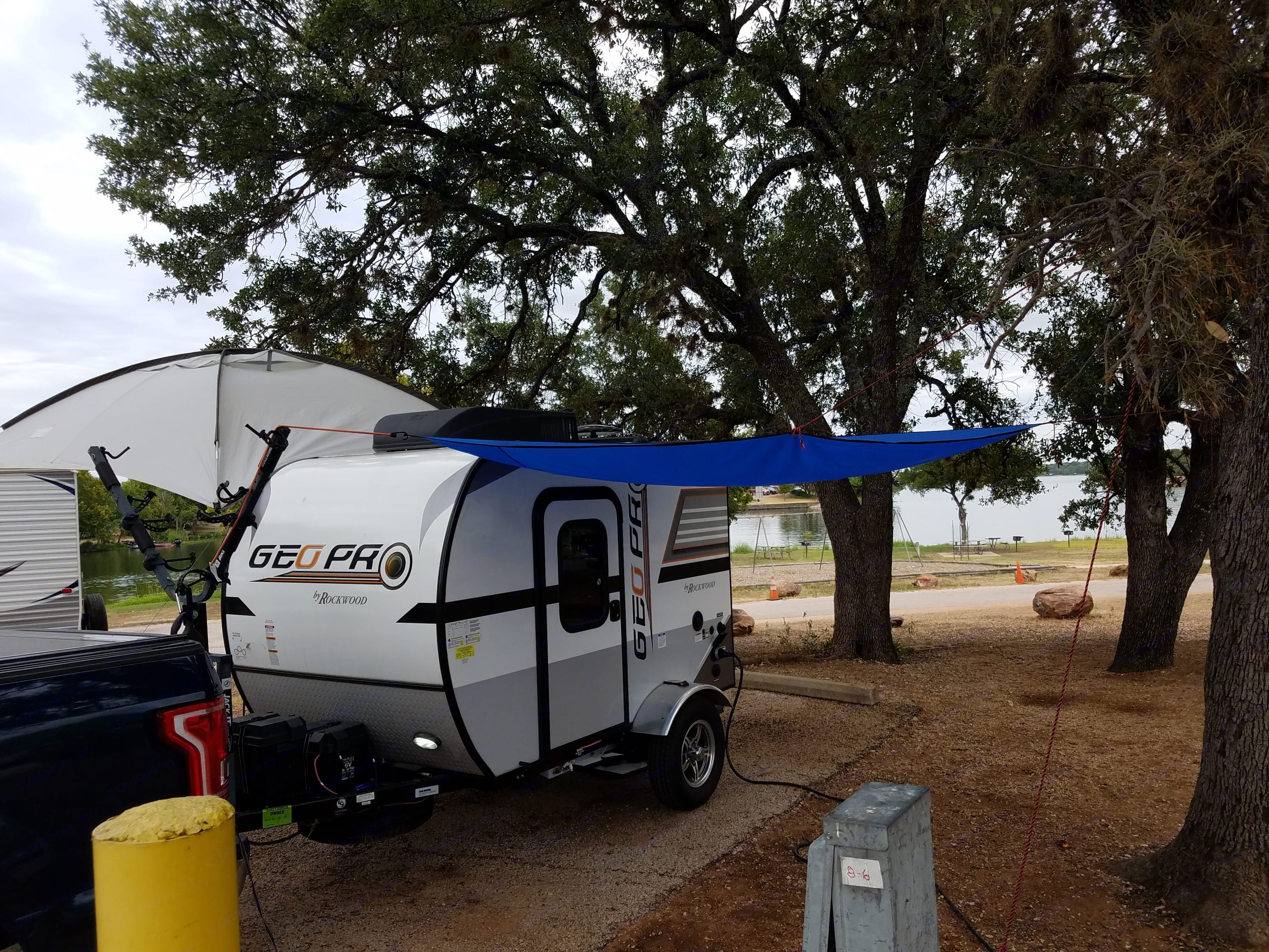 There is also a small awning for the other side. Poles are available or attach to trees.. rockwood Geo Pro 12RK 2017