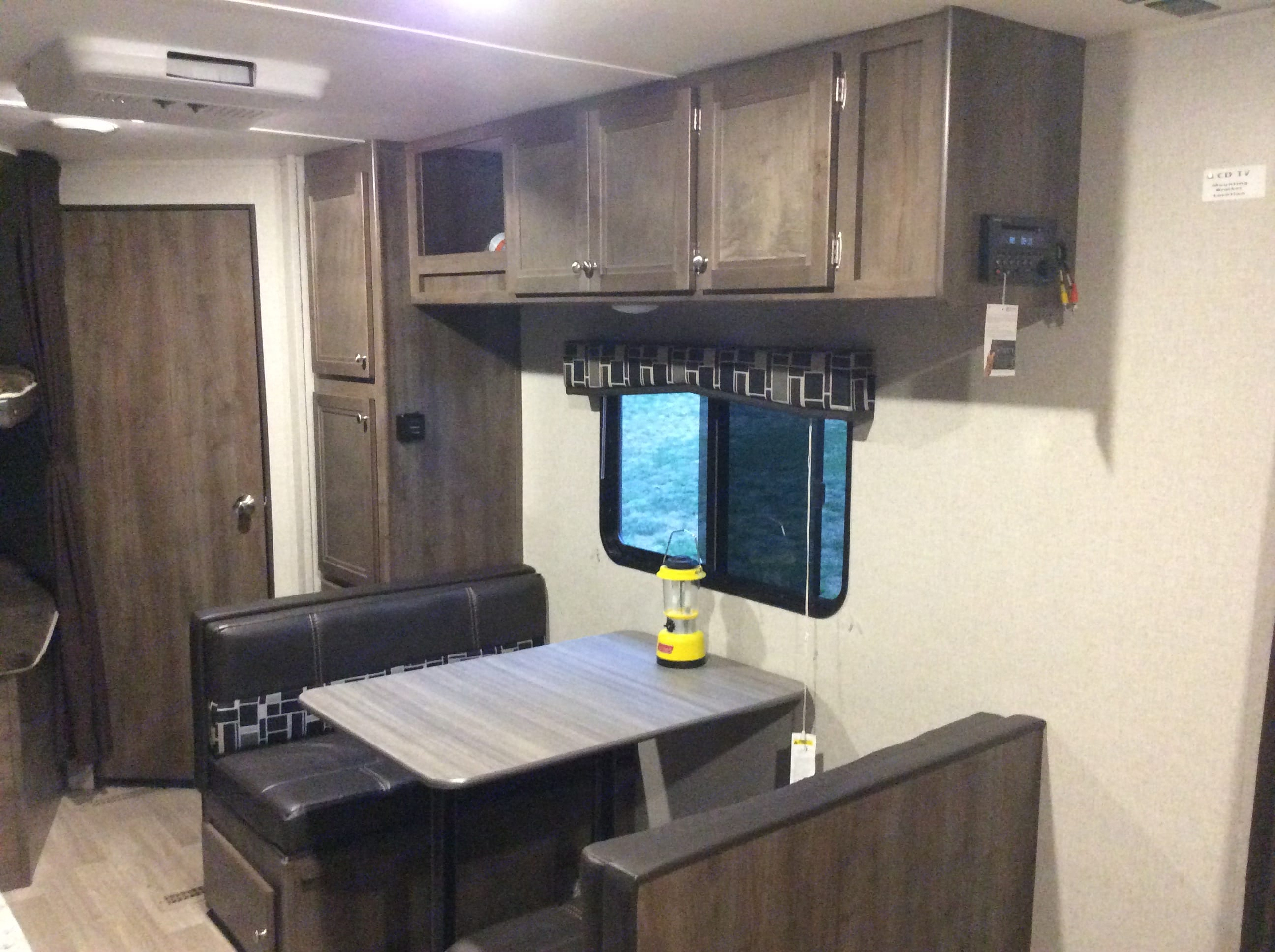 Dining area with storage above & under each bench.. Coleman Lantern 2018