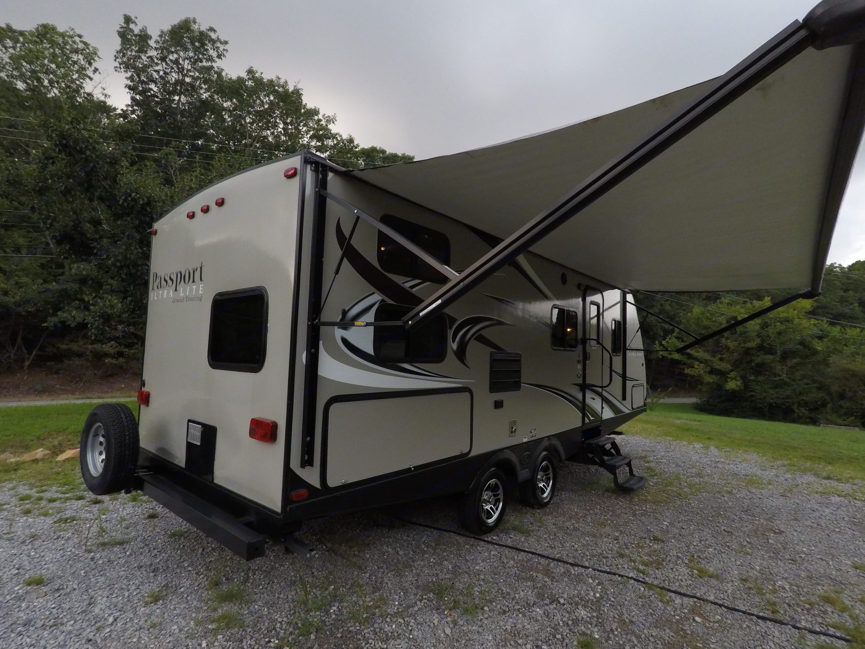Huge awning sets this camper apart. It runs almost the entire length of the camper, *including* the outdoor kitchen!  **Many camper awnings do *not* cover the outdoor kitchen area!  It's one of our favorite features! . Keystone Passport 2400BH Grand Touring * UltraLite 2016
