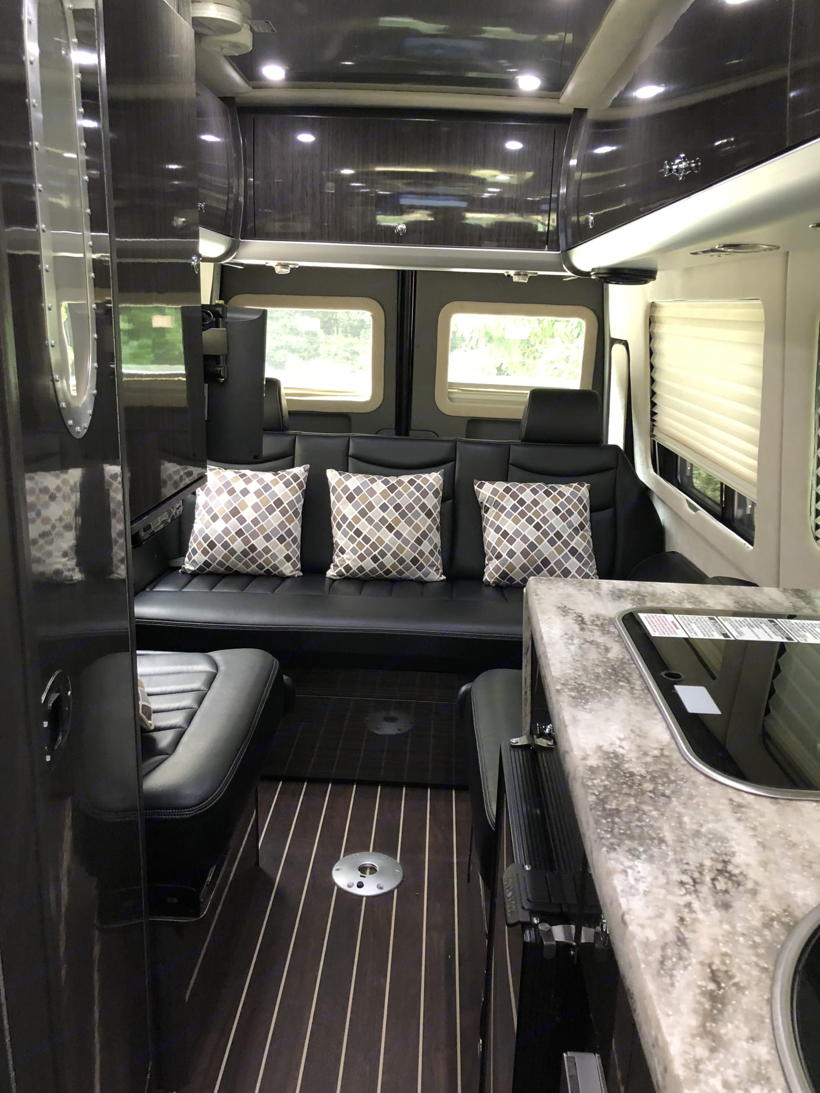 Bench seating for four, plus oversized ottoman . Airstream Interstate 2014
