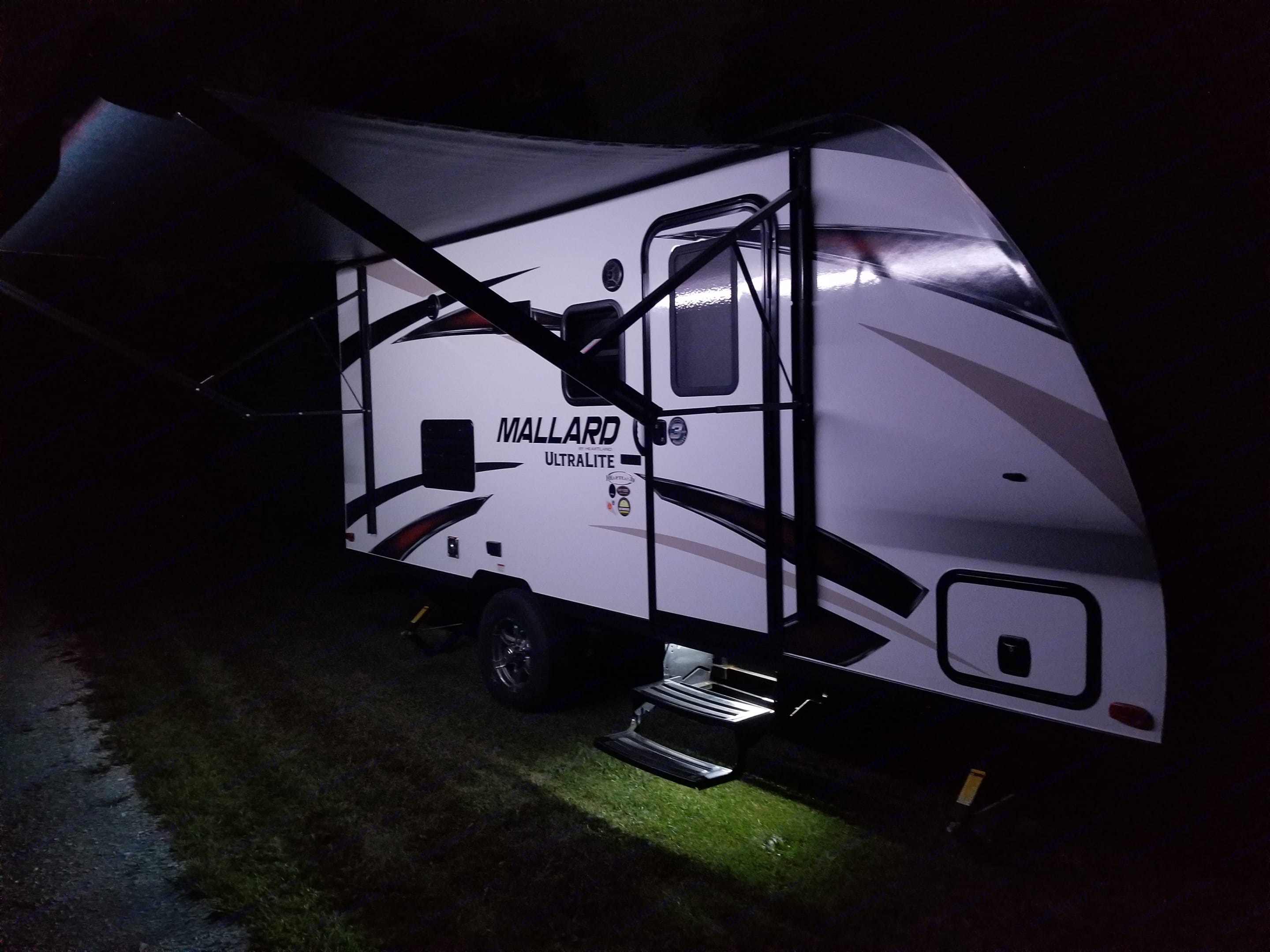 Lit Up from the Awning LED Light Bar that Changes Colors and Brightness with a Remote Control. Heartland M185 2018