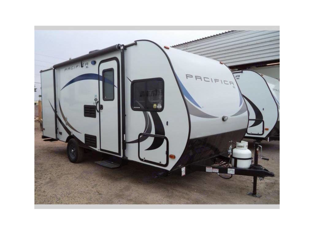 Outside with awning, extra storage, and electrical plugs.. Pacific Coachworks Pacifica XL 2018
