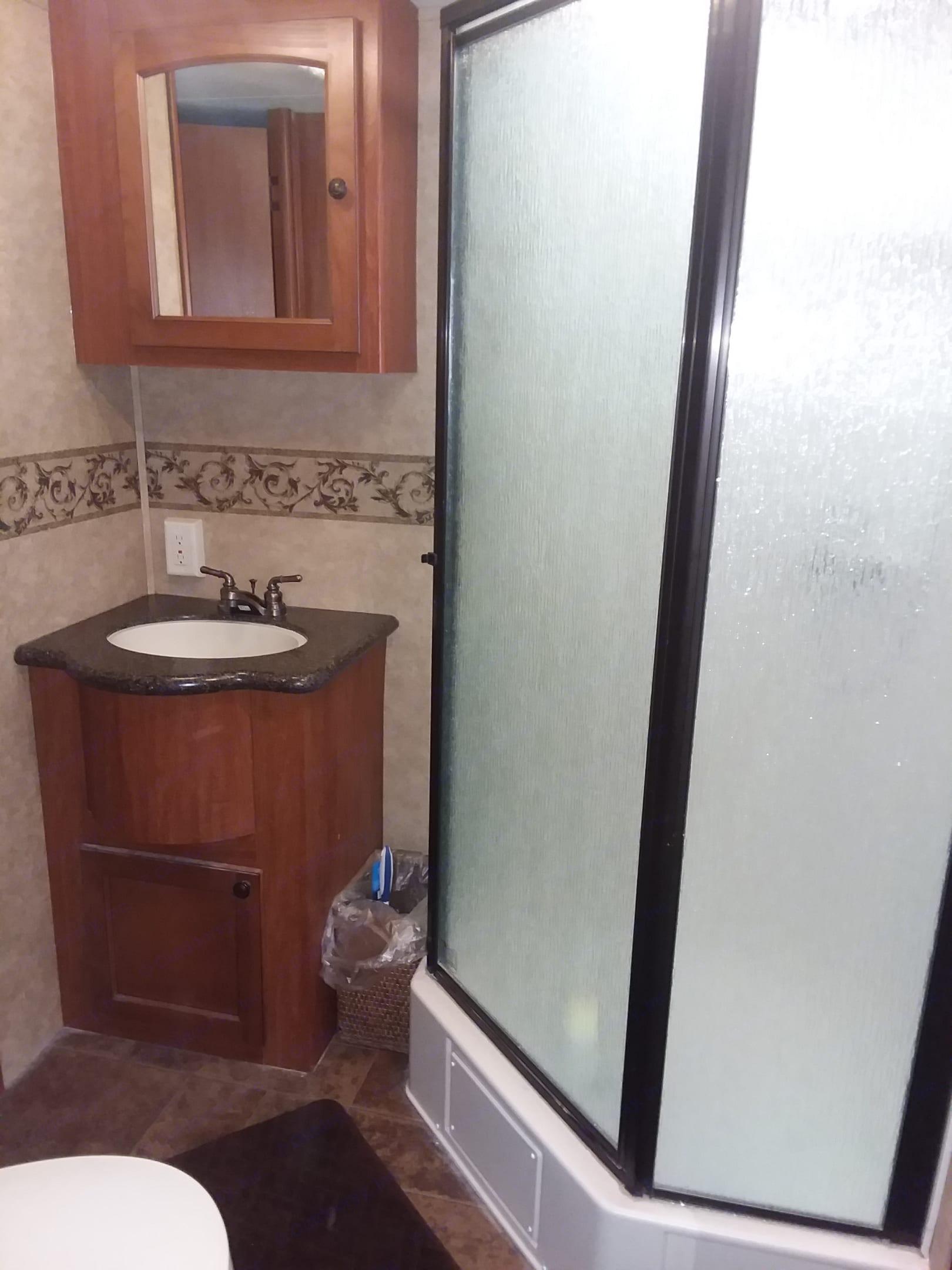 Bathroom sink and walk-in shower.. Heartland Caliber 2012