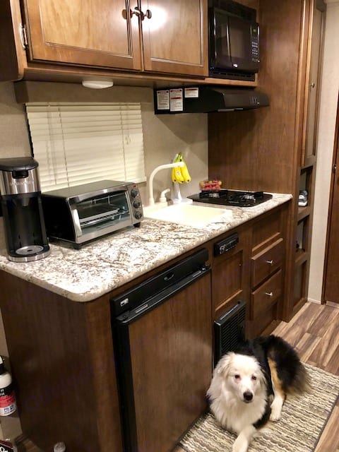 Fully stocked kitchen with microwave, gas range, fridge, toaster oven, & all cooking/eating utensils.. Keystone Hideout 2018