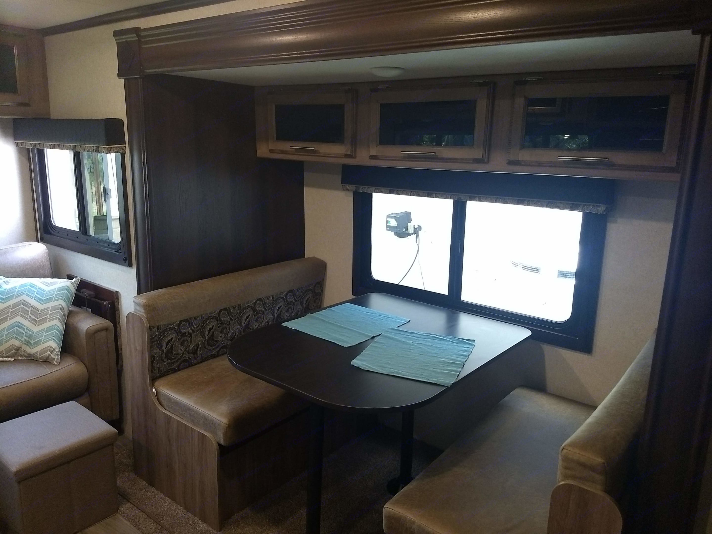 Dining area - Seats 4 very comfortable. Converts to bed. Jayco Jay Feather 2018