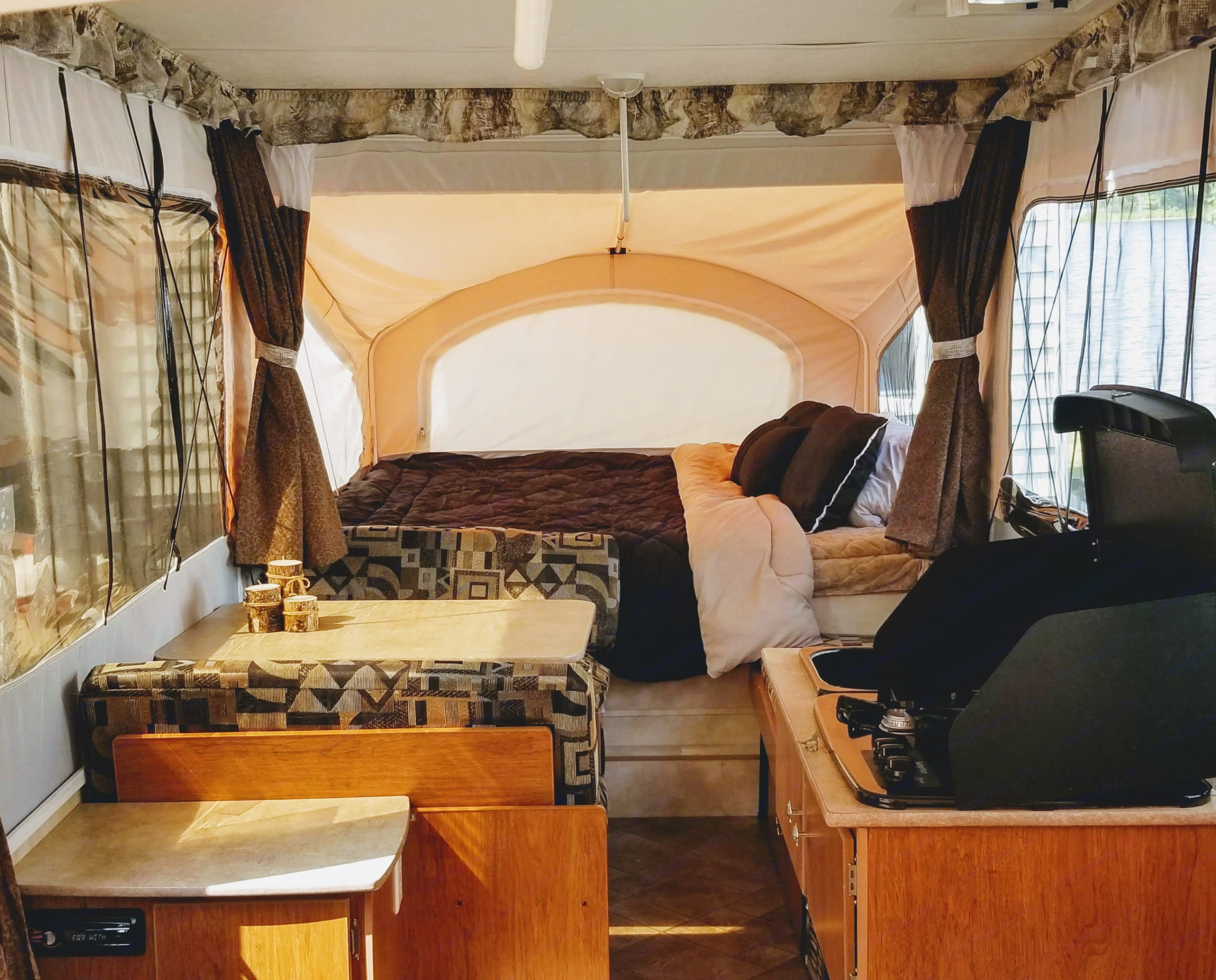 Dinette that collapses into a bed, King Size Bed at the end, Stove and Sink on the Right side.. Coachmen Clipper 2011