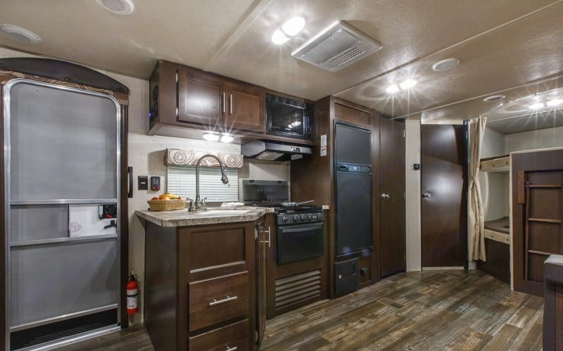 Kitchen with plenty of storage in large pantry.. Forest River Cherokee Grey Wolf 26DBH 2018