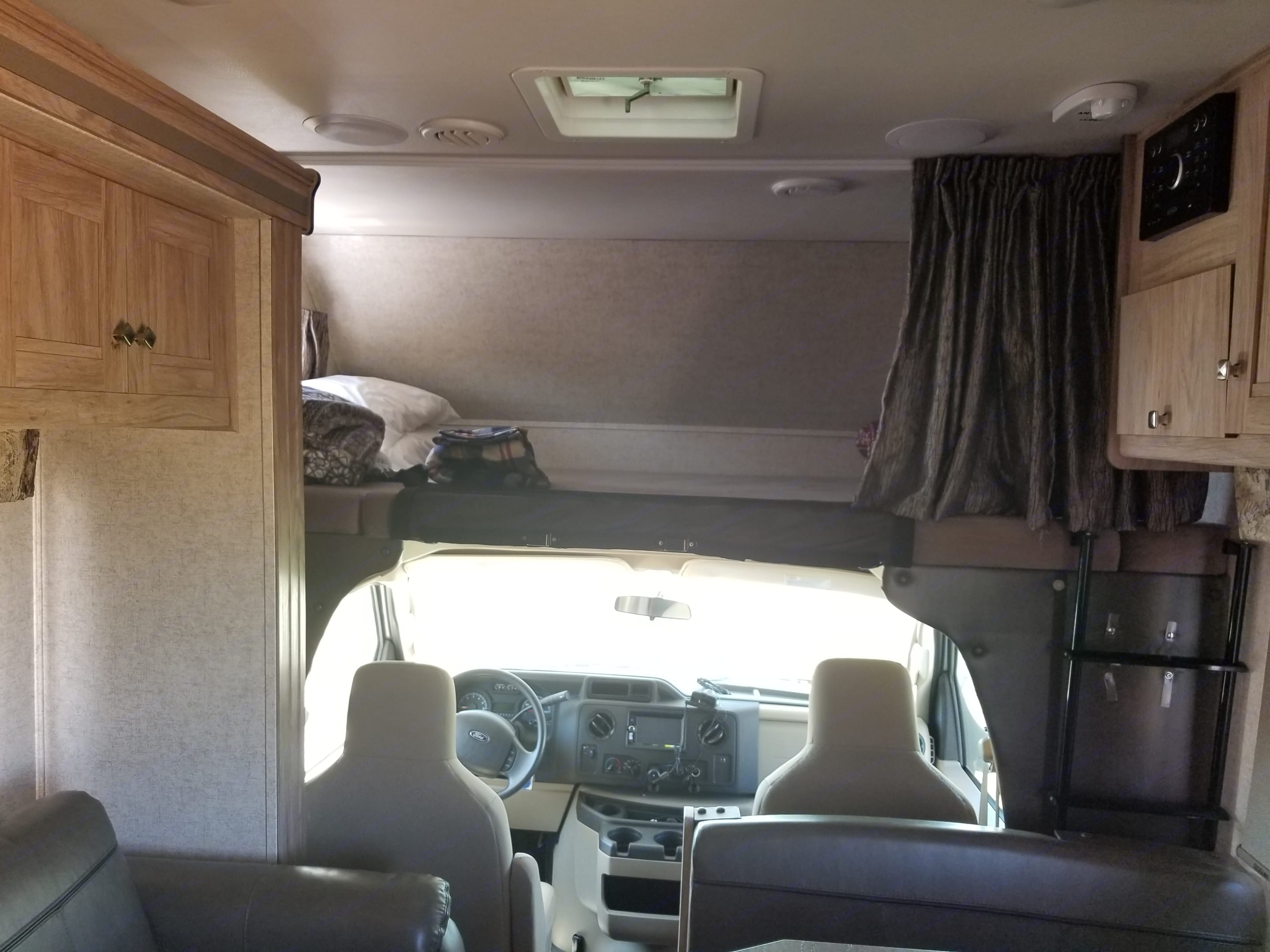 loft bed above drivers seat. sleeps 2. Forest River Forester 2017